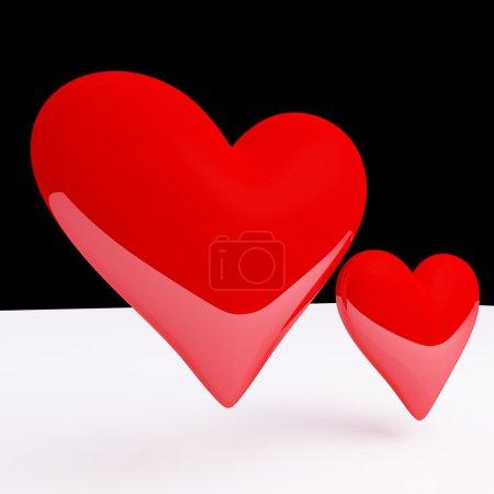 Photo pour Fine image 3D de deux cœurs rouges et fond noir et blanc - image libre de droit
