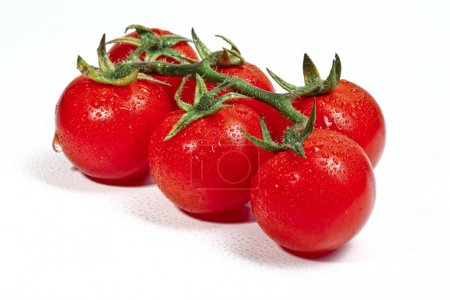 Photo for Closeup image of red tomatoes on white plane - Royalty Free Image