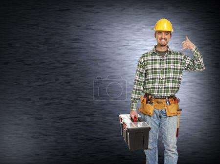 Handyman and metal background