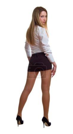 Foto de La bella joven en una camisa blanca y pantalones negros. aislamiento sobre un fondo blanco - Imagen libre de derechos