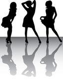 Silhouettes of three dancing girls