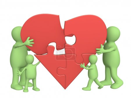 Photo for Family love - heart from parts of a puzzle - Royalty Free Image