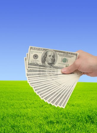 Photo for Hand, holding many of dollar banknotes - Royalty Free Image