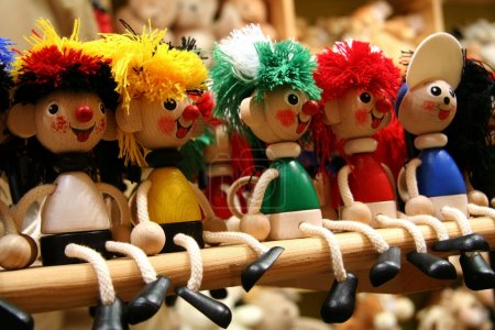 Row of five wooden toys