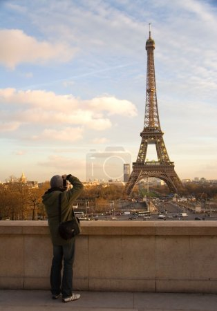 Tourist taking picture of Eiffel Tower
