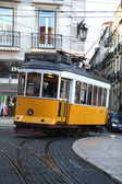 Old fashioned yellow tram in Lisbon