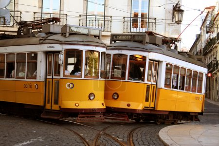 Old fashioned yellow trams in Lisbon