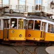Two old fashioned yellow trams in Lisbon, Portugal...