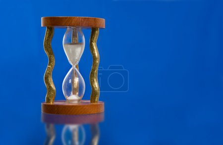 Hourglass on blue background