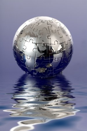 Foto de Puzzle globo sobre fondo azul - Imagen libre de derechos