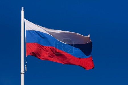 Photo pour Waving flag of Russian Federation against the clear blue sky - image libre de droit