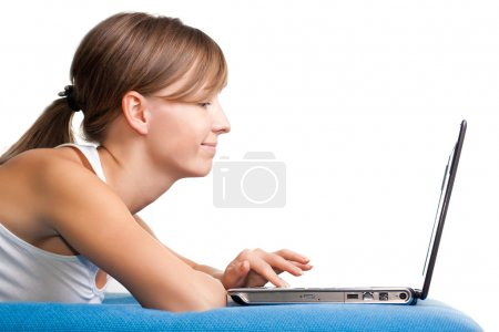 Young girl chatting using her laptop
