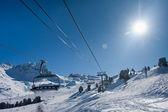 Chairlift on ski resort. Up