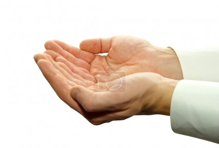 Foto de Una mano mendigando limosna sobre un fondo blanco - Imagen libre de derechos