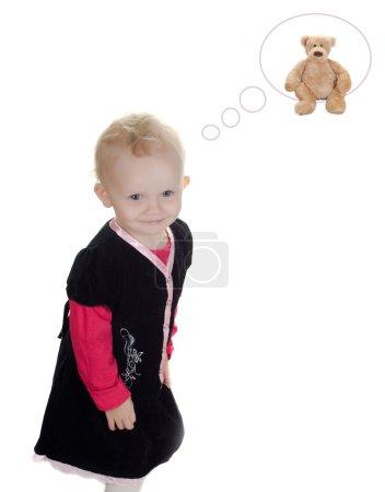 Foto de Foto de niña que soñando con juguete - Imagen libre de derechos