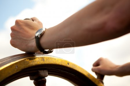 Photo for Hand on ship rudder. - Royalty Free Image