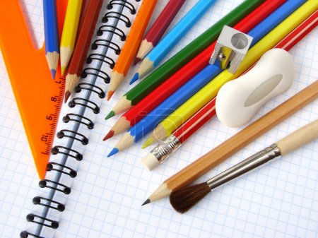 Photo for Educational tools set on the spiral notepad background - Royalty Free Image