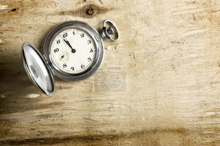 Photo for Old clock on a wooden table - Royalty Free Image