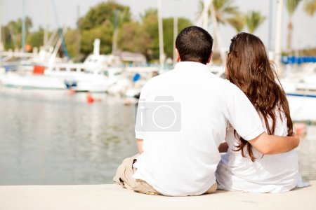 Young Couple Seated On A Footbridge