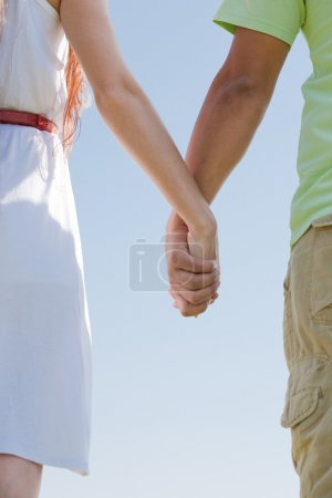 Young couple holding hands