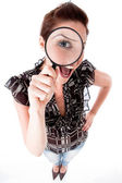 Women looking with magnifying glass