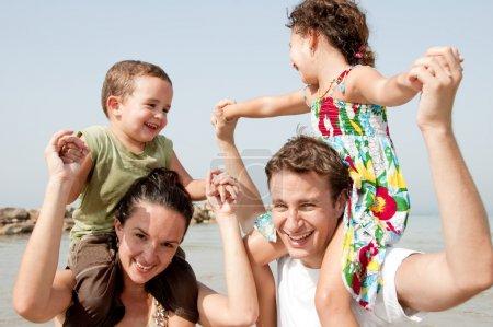 Children sitting on parents shoulders