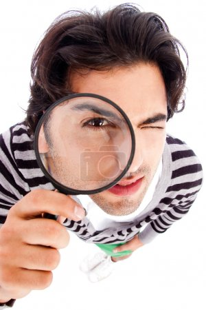 Man looking with magnifying glass
