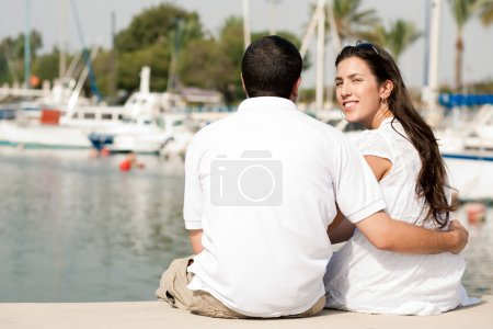 Couple sitting at the harbor