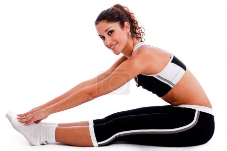 Woman in fitness outfits stretching