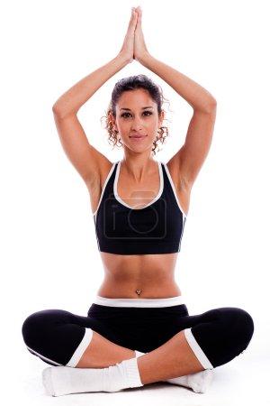Girl sitting in yoga posture