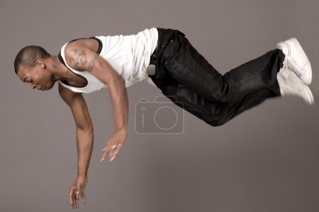 Dancer jumping to the floor