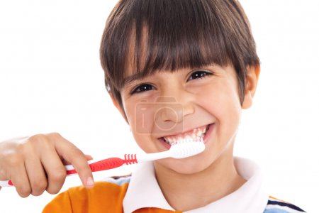 Closeup of cute kid brushing his teeth