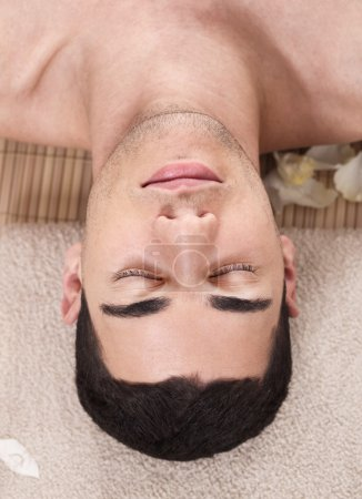 Photo for Caucasian handsome spa man ready to take massage outdoor - Royalty Free Image