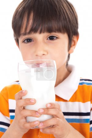 Photo for Happy kid drinking glass of milk on isolated background - Royalty Free Image