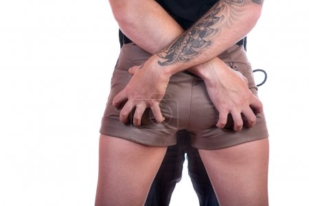 Man's hands on female buttocks