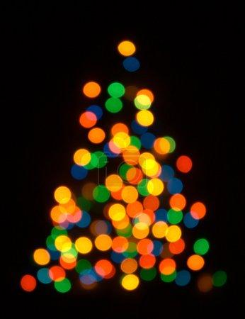 Christmas fur tree shaped defocused back
