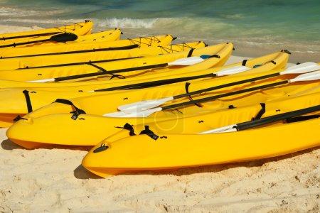 Kayaks on the beach sand