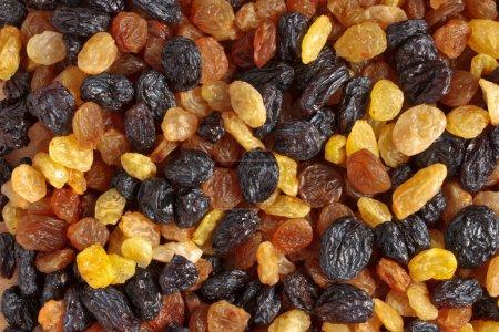 Mixed raisins of different colors close up...