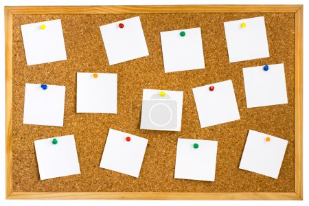 Cork board with pinned white notes
