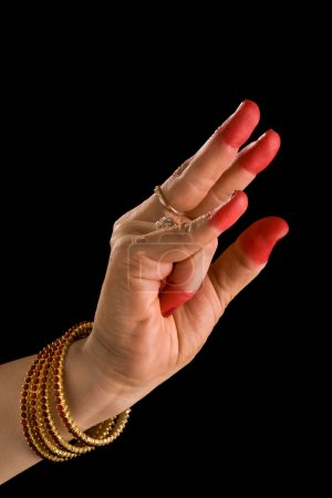 """Photo for Woman hand showing Kangula hasta (hand gesture, also called mudra) (meaning """"Tail"""") of indian classic dance Bharata Natyam. - Royalty Free Image"""