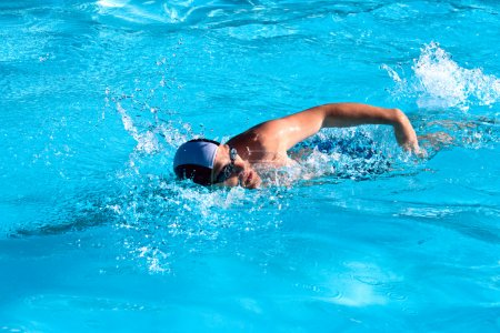 Photo for Athletic Man swimming in the pool - Royalty Free Image
