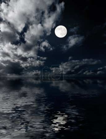 Moon and clouds above sea at night
