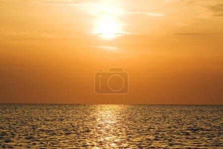 Orange sunset above a quiet serene gulf
