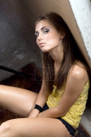 The sexy young beauty woman sitting near