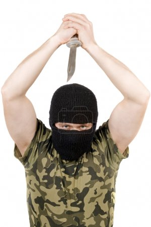The killer with a knife in a black mask