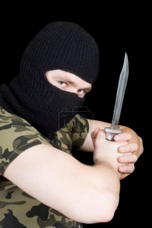 Photo for The criminal with a knife in a black mask - Royalty Free Image