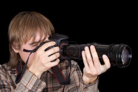 Photo pour Photographe avec l'appareil photo avec un objectif zoom - image libre de droit