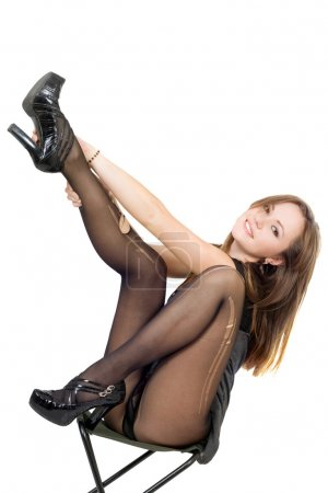 Beautiful girl in the torn stockings sit