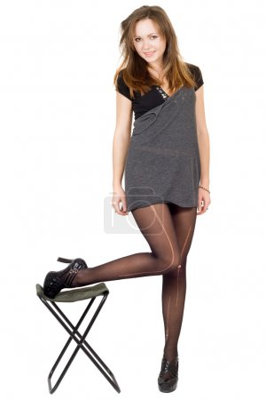 Young woman in the torn stockings and a
