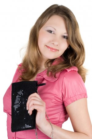 Beautiful young woman with a handbag. Is